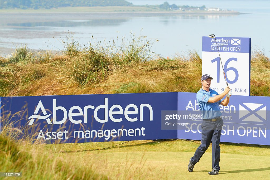 <a gi-track='captionPersonalityLinkClicked' href=/galleries/search?phrase=Padraig+Harrington&family=editorial&specificpeople=175865 ng-click='$event.stopPropagation()'>Padraig Harrington</a> of Ireland tees off during the first round of the Aberdeen Asset Management Scottish Open at Castle Stuart Golf Links on July 11, 2013 in Inverness, Scotland.
