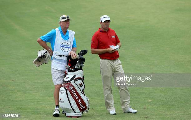 Padraig Harrington of Ireland waits to play his second shot at the par 4 17th hole with his standin caddy Pat Cashman of Ireland who stood in when...