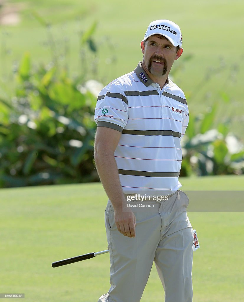 Padraig Harrington of Ireland walks to the green on the par 5, 18th hole during the first round of the 2012 DP World Tour Championship on the Earth Course at Jumeirah Golf Estates on November 22, 2012 in Dubai, United Arab Emirates.