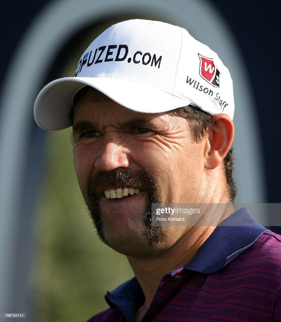 Padraig Harrington of Ireland with his 'Momvember' mustache during the pro-am event prior to the DP World Tour Championship on the Earth Course at Jumeirah Golf Estates on November 20, 2012 in Dubai, United Arab Emirates.