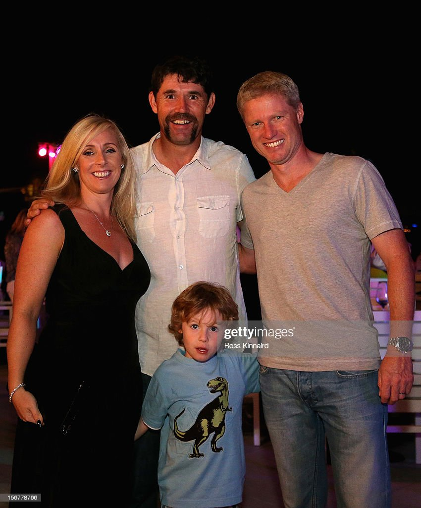 Padraig Harrington of Ireland with his wife Caroline, his son Ciaran and his caddie Ronan Flood at the pro-am party prior to the DP World Tour Championship on the Earth Course at Jumeirah Golf Estates on November 20, 2012 in Dubai, United Arab Emirates.