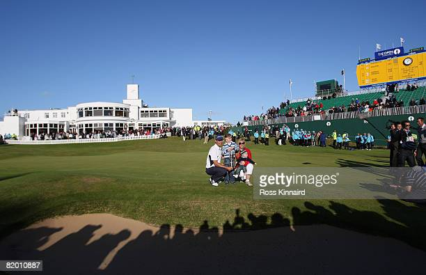 Padraig Harrington of the Republic of Ireland celebrates with the Claret Jug with wife Caroline and sons Patrick and Ciaran after winning by 4...