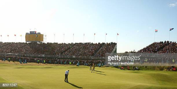 Padraig Harrington of the Republic of Ireland putts on the 18th green to take a 4 stroke victory during the final round of the 137th Open...