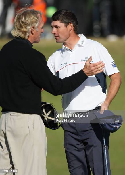 Padraig Harrington of the Republic of Ireland shakes hands on the 18th green with Greg Norman of Australia as he wins by 4 strokes during the final...