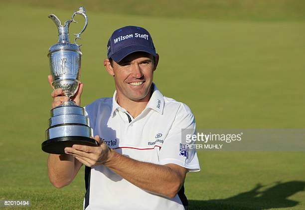 Padraig Harrington of the Republic of Ireland shows the Claret Jug after winning The Open golf tournament at Royal Birkdale in Southport in northwest...