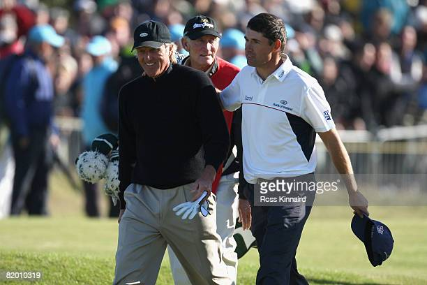 Padraig Harrington of the Republic of Ireland walks to the 18th green with Greg Norman of Australia during the final round of the 137th Open...