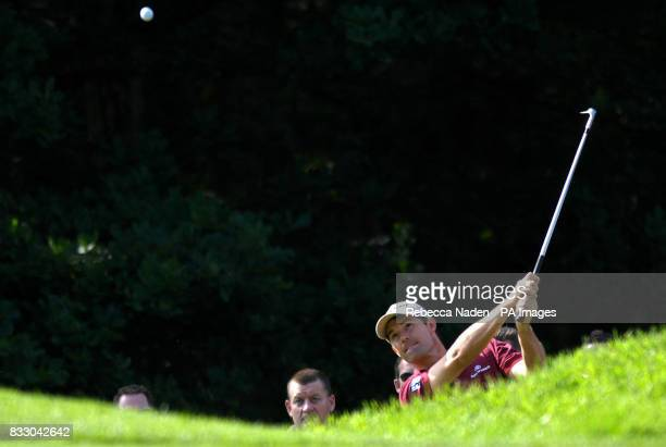 Padraig Harrington plays his 3rd shot after his second shot on the 1st hole finished on top of a spectator's backpack during the Second Round of the...