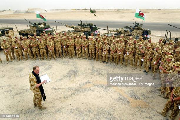 Padre Captain Mark GrantJones gives a service to B Company of the First Queen's Dragoon Guards as they get prepared to move out to help give support...