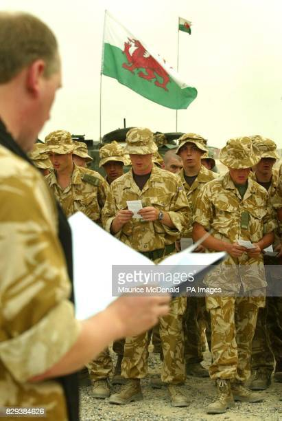 Padre Captain Mark GrantJones gives a service to B Company of the First Queen Dragoon Guards as they get prepared to move out to help give support to...