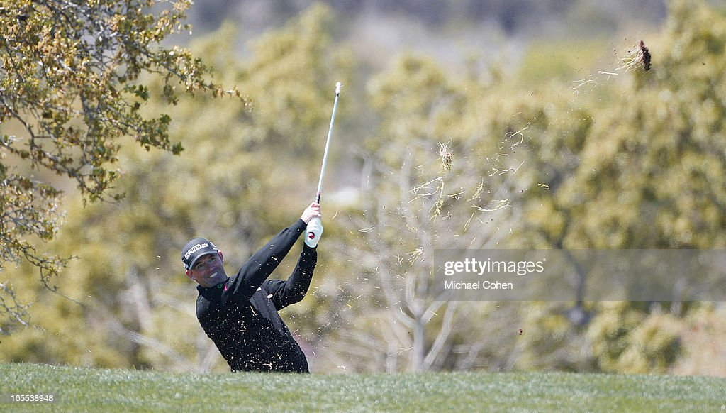 Padriaig Harrington of Ireland hits his second shot on the 18th hole from the rough during the first round of the Valero Texas Open held at the AT&T Oaks Course at TPC San Antonio on April 4, 2013 in San Antonio, Texas.