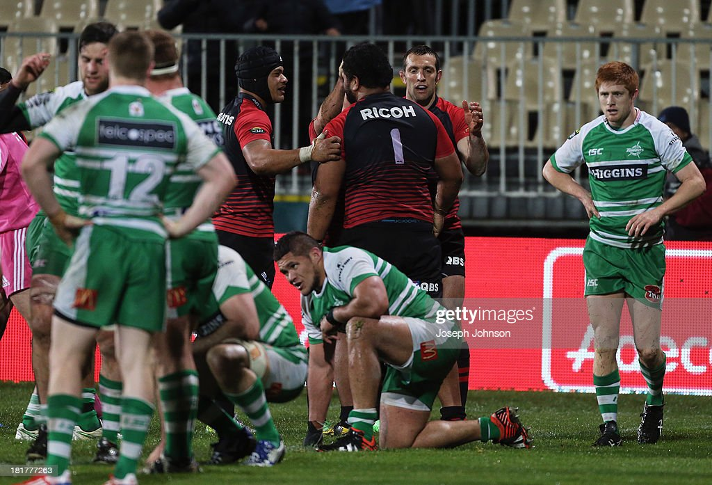 Paea Fa'anunu of Canterbury is congratulated by Jordan Taufua and Adam Whitelock after his try during the round 7 ITM Cup match between Canterbury and Manawatu at AMI Stadium on September 25, 2013 in Christchurch, New Zealand.