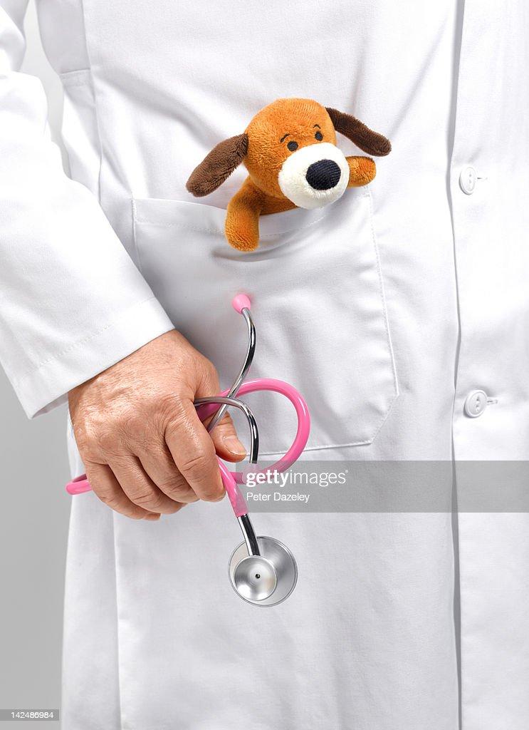 Paediatrician holding stethoscope : Stock Photo
