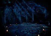 Old paganist temple in night forest