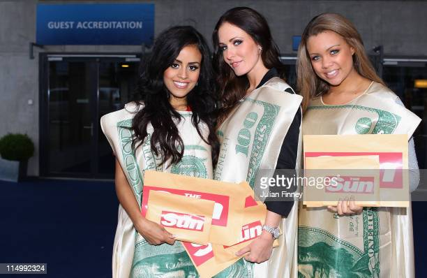 Page 3 girls from the Sun Newspaper stand outside the entrance to the Hallenstadion during the 61st FIFA Congress at Hallenstadion on June 1 2011 in...