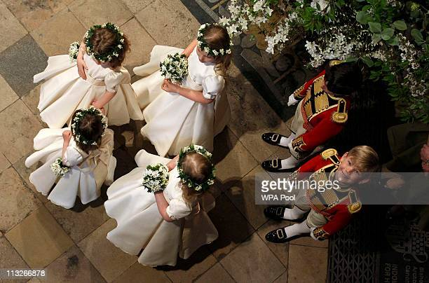 Page boy Tom Petiffer looks up as he waits with bridesmaids and page boys inside the Westminster Abbey before the wedding of Prince William to...