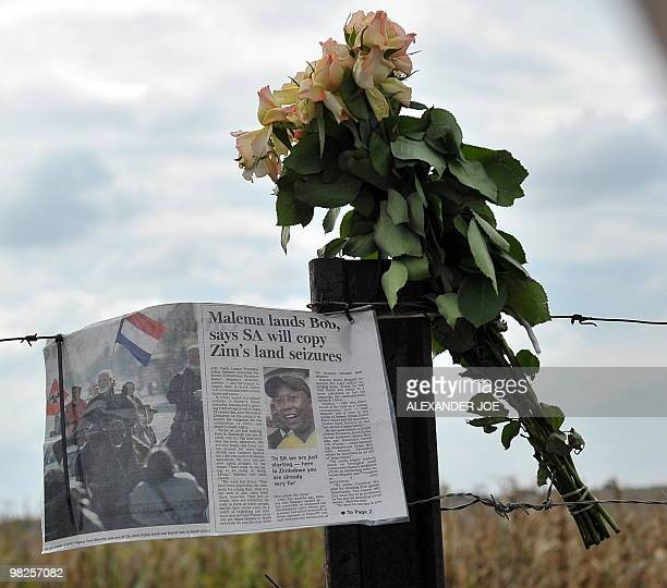 A page of a newspaper portraiting ANC youth leader Julius Malema hangs to the fence next to flowers to pay tribute to African farright leader Euguene...