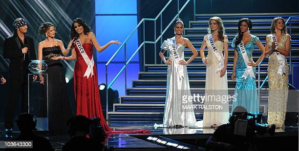 Pageant hosts Bret Michaels and Natalie Morales watch as Miss Mexico Jimena Navarrete answers a question before winning the Miss Universe 2010...