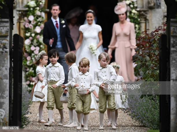 Pageboy Prince George of Cambridge leads the bridesmaids and pageboys out of church after his aunt Pippa Middleton marries James Matthews following...