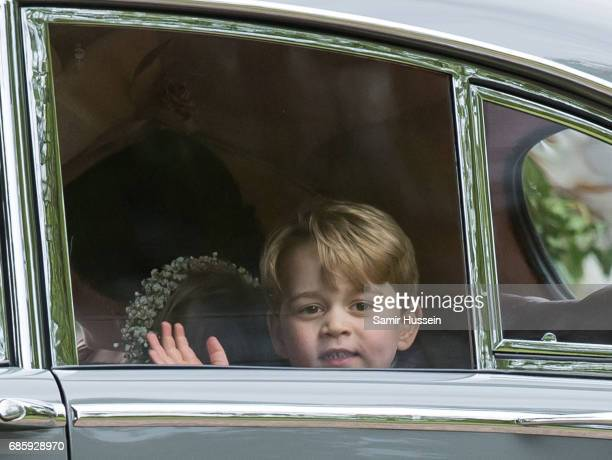 Pageboy Prince George of Cambridge waves as he leaves by car the wedding Of Pippa Middleton and James Matthews at St Mark's Church on May 20 2017 in...