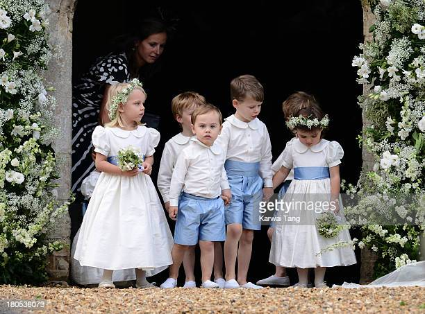 Pageboys and bridesmaids attend the wedding of James Meade and Lady Laura Marsham at The Parish Church of St Nicholas in Gayton on September 14 2013...