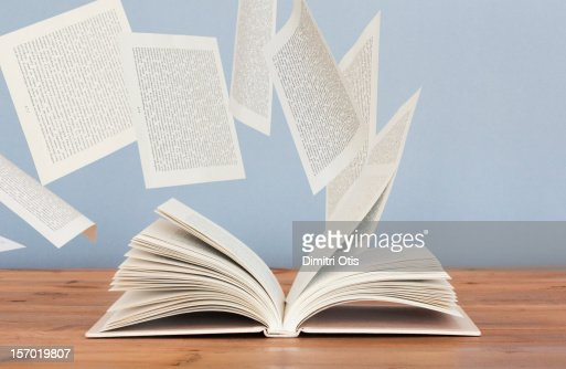 Pages of a book flying away in the wind