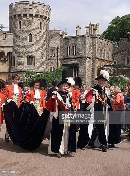 Pages Of Honour Carrying The Train Of The Queen's Mantle As She And Prince Philip [ Duke Of Edinburgh] Walk To The Chapel For The Order Of The Garter...
