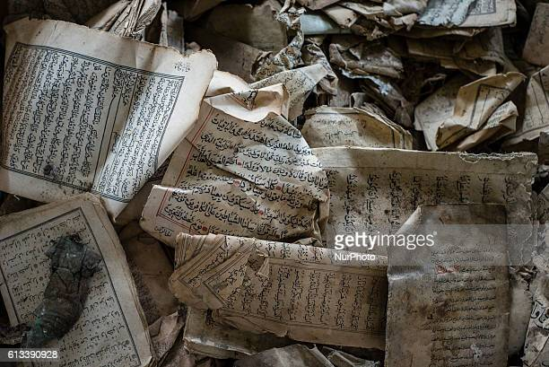 Pages of torn Koran remain in a box at an old closed mosque in Lezghi village in Caucasian mountains Azerbaijan Villages in Qusar region had their...