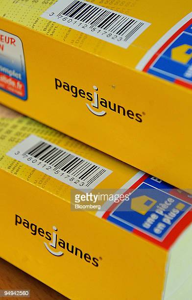 PagesJaunes telephone directories are displayed for a photograph in Paris France on Tuesday Feb 24 2009 The company releases its earnings tomorrow