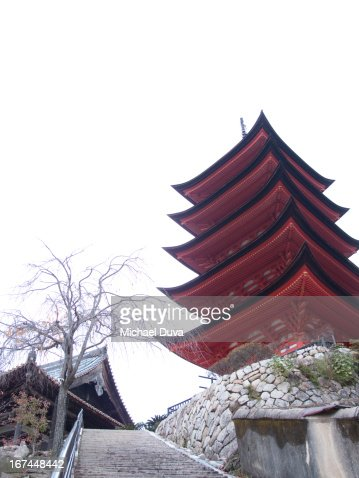 pagoda and shrine above stairs in miyajima : Stock Photo