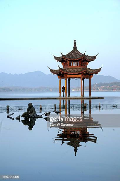 Pagoda and Statue - West Lake