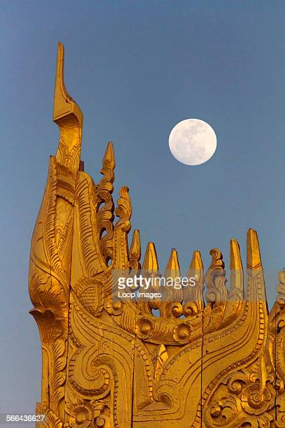 A pagoda on top of Mandalay Hill in Myanmar viewed by moonlight