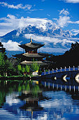 Pagoda reflected in Black Dragon Pool in front of Jade Dragon Snow Mountain (Mt Satseto), Lijiang, China