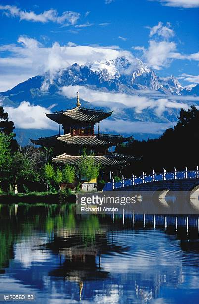Pagoda reflected in Black Dragon Pool in front of Jade Dragon Snow Mountain (Mt Satseto), Lijiang, China