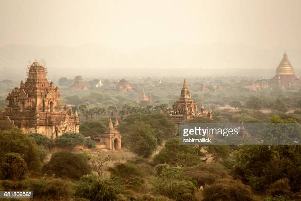 pagodas and the mist at sunset in Bagan, Mandalay, Myanmar