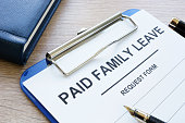 Paid family leave form in clipboard and note pad.
