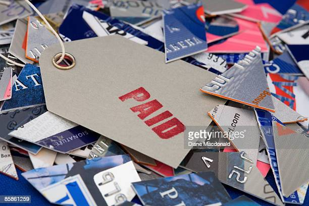 A paid label on top of cut up credit cards
