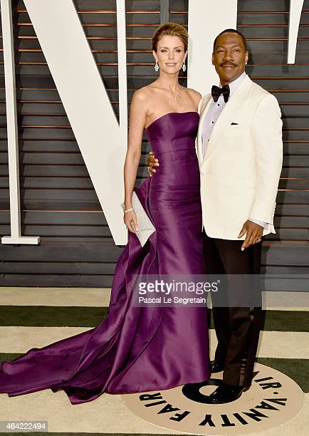 Paige Butcher and actor Eddie Murphy attend the 2015 Vanity Fair Oscar Party hosted by Graydon Carter at Wallis Annenberg Center for the Performing...