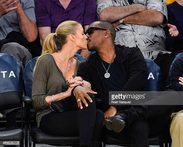 Paige Butcher and Eddie Murphy kiss at a basketball game between the Dallas Mavericks and the Los Angeles Lakers at Staples Center on April 12 2015...