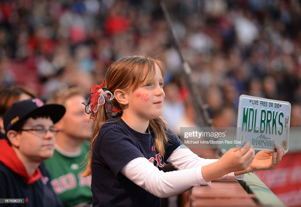 Paige Knudsen of Brookline, New Hampshire holds a license plate with the last name of Will Middlerbooks #16 of the Boston Red Sox during his at-bat against the Houston Astros in the first inning on April 25, 2013 at Fenway Park in Boston, Massachusetts.