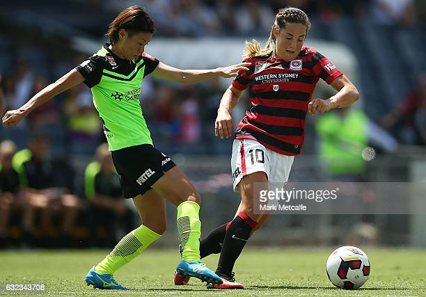 Paige Nielsen of the Wanderers is challenged by Yukari Kinga of Canberra during the round 13 WLeague match between the Western Sydney Wanderers and...