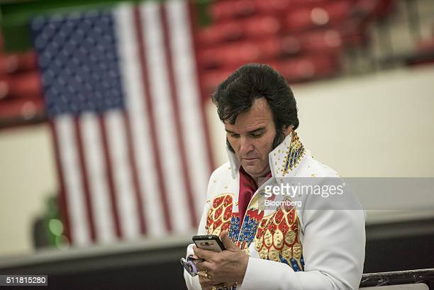 Paige Poole an Elvis Presley impersonator checks his messages as he waits to hear Donald Trump president and chief executive of Trump Organization...