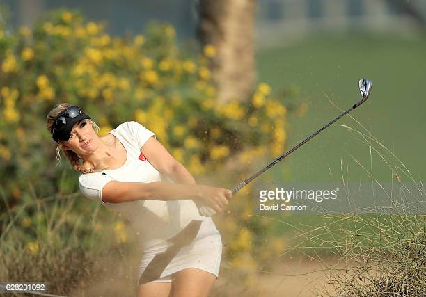 Paige Spiranac of the United States plays her fourth shot on the tenth hole during the first round of the 2016 Omega Dubai Ladies Masters on the...