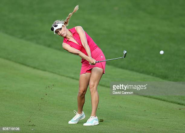 Paige Spiranac of the United States plays her second shot at the 14th hole during the delayed second round of the 2016 Omega Dubai Ladies Masters on...