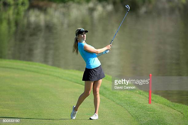 Paige Spiranac of United States plays her fourth shot at the par 4 9th hole during the first round of the 2015 Omega Dubai Ladies Masters on the...