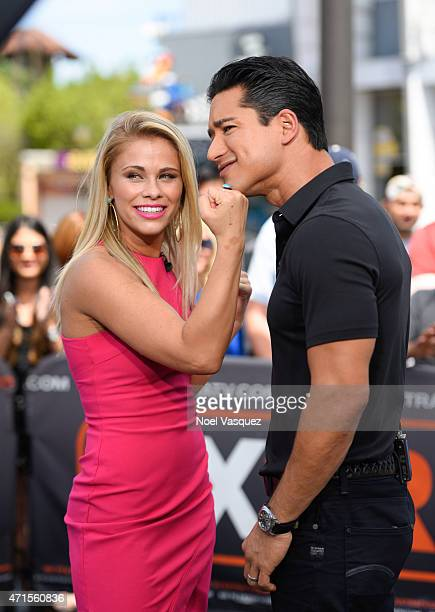 Paige VanZant and Mario Lopez visit 'Extra' at Universal Studios Hollywood on April 29 2015 in Universal City California