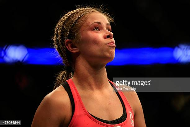 Paige VanZant celebrates defeating Felice Herrig in their women's strawweight bout during the UFC Fight Night event at Prudential Center on April 18...