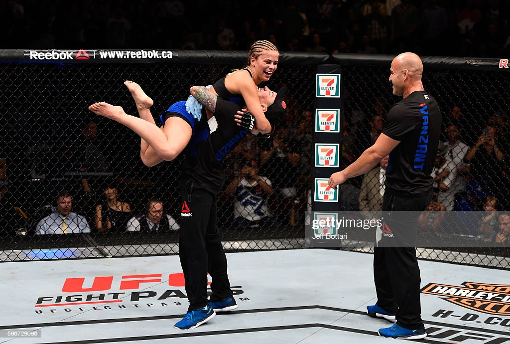 Paige VanZant of the United States celebrates her knockout victory over Bec Rawlings of Australia in their women's strawweight bout during the UFC Fight Night event at Rogers Arena on August 27, 2016 in Vancouver, British Columbia, Canada.