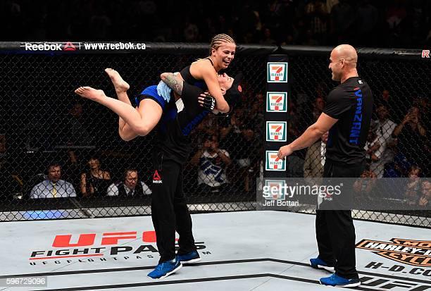 Paige VanZant of the United States celebrates her knockout victory over Bec Rawlings of Australia in their women's strawweight bout during the UFC...
