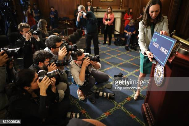 Paige Waltz digital media coordinator for Speaker of the House Paul Ryan prepares signage as the House votes on the Tax Cuts and Jobs Act in the...