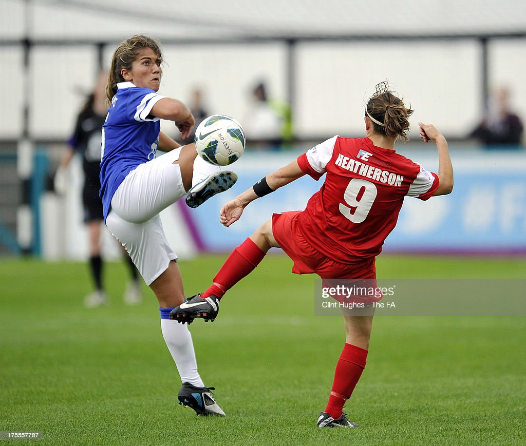 Paige Williams (L) of Everton Ladies FC and Anne Marie Heatherson of Bristol Academy Women's FC battle for the ball during the FA WSL match between Everton Ladies FC and Bristol Academy Women's FC at the Arriva Stadium on July 4, 2013 in Liverpool, England